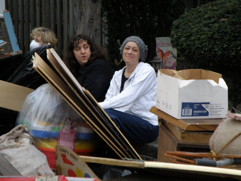 Clawson - Sandy's Fury - Photo 3 - Ladies sitting with trash